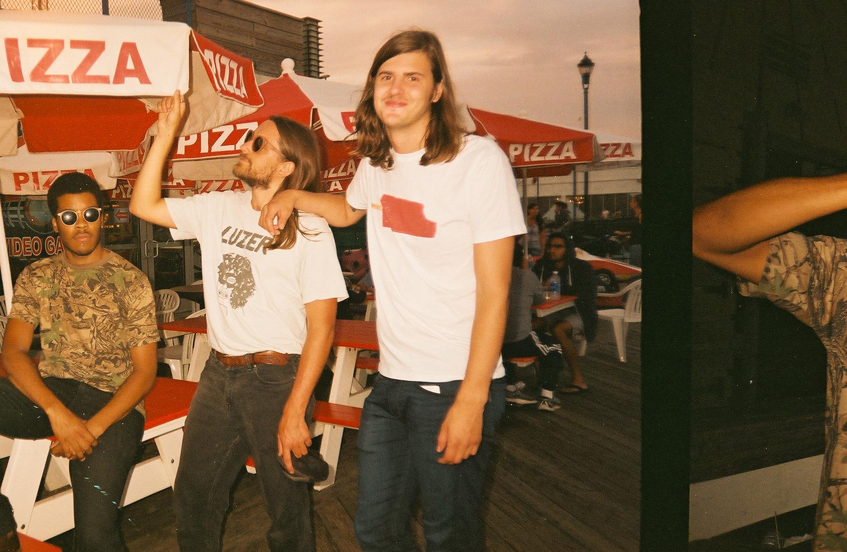 Nick, Grady, Sam outside a pizza place on Asbury Boardwalk