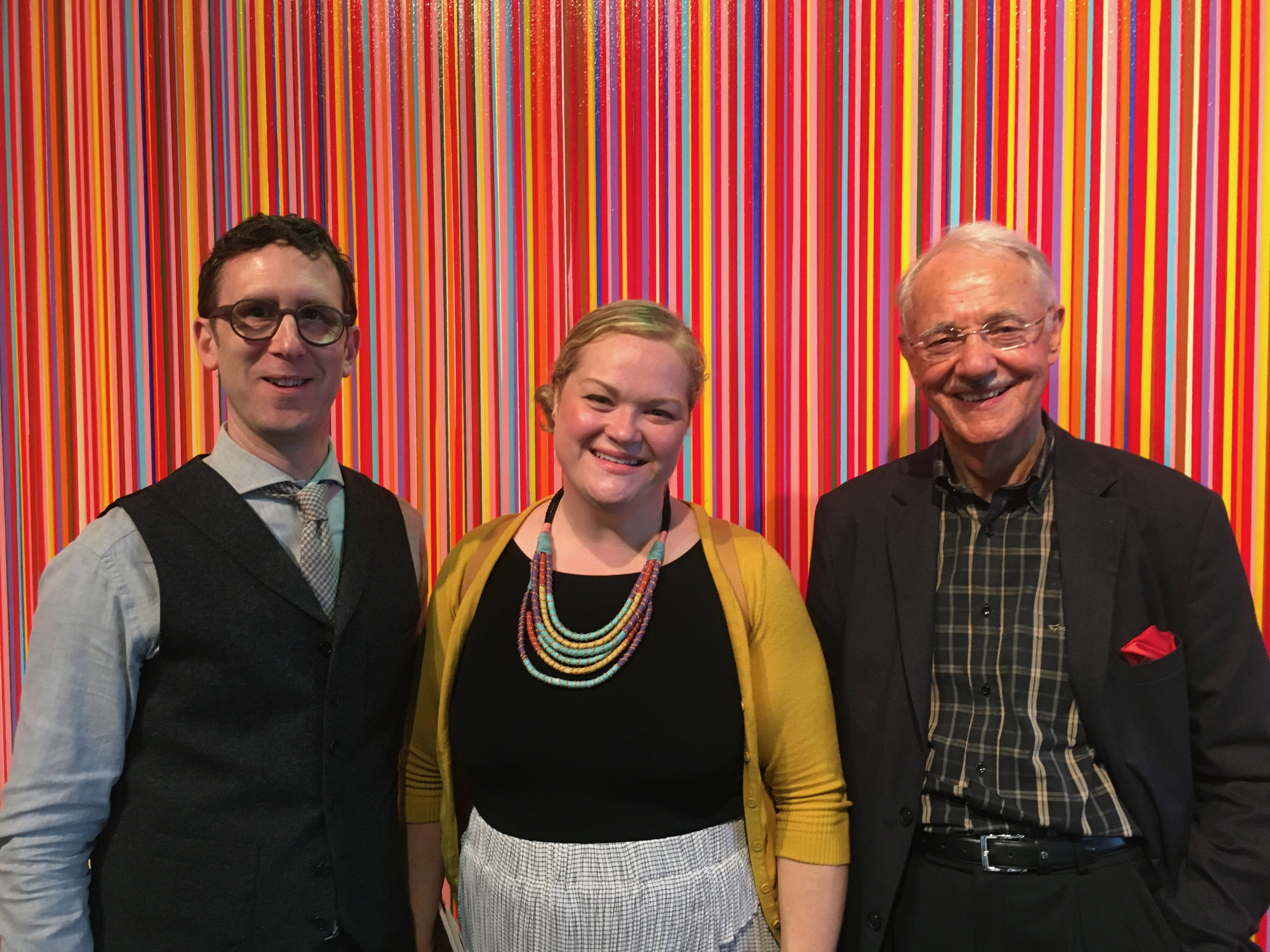 John Silvis, WSJ journalist Kelly Crow Hayes and Mr. Karlheinz Essl at The Armory Show NY Pier 92. Background: Work on canvas by Jun Kaneko