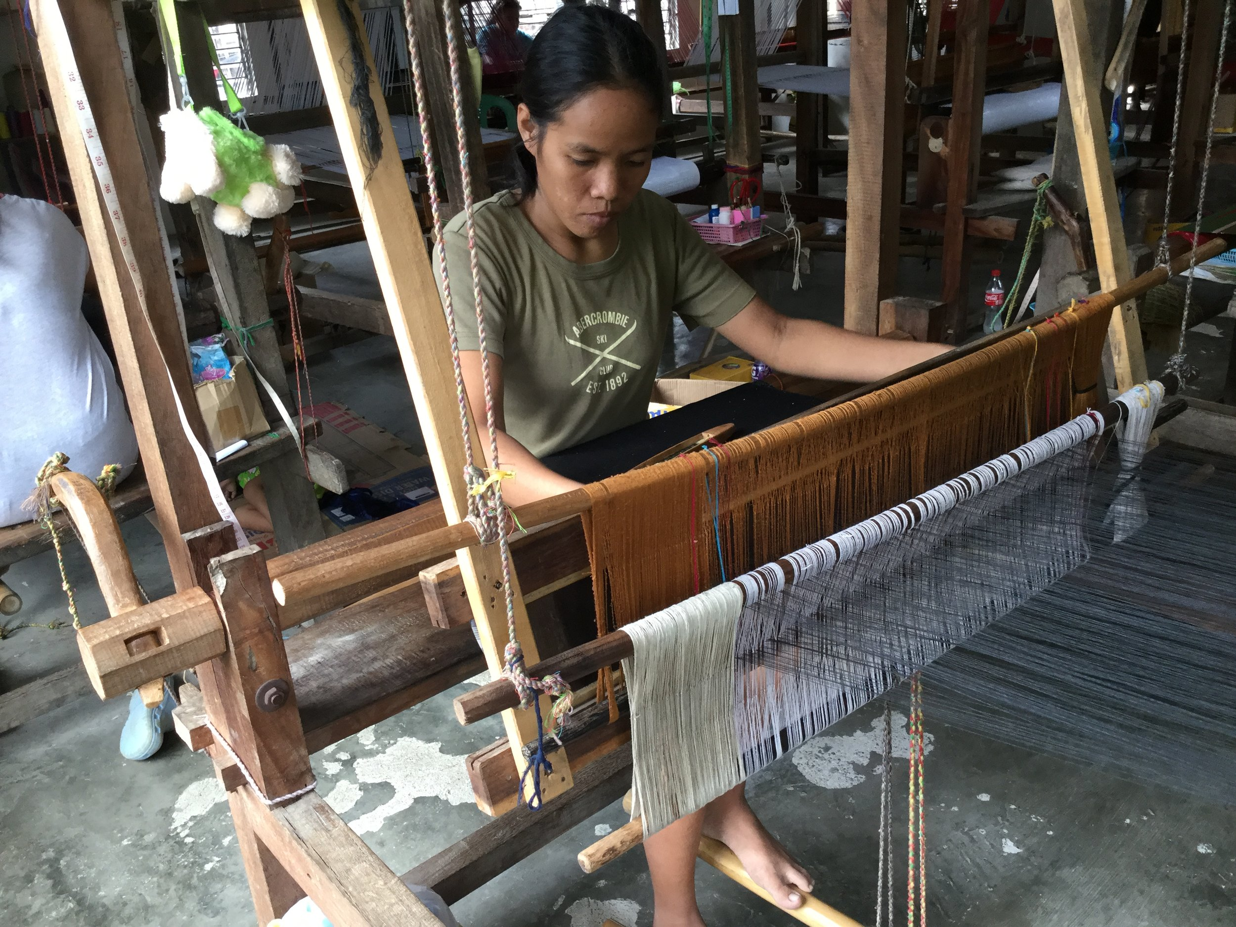 Picture of weaver working on the loom.