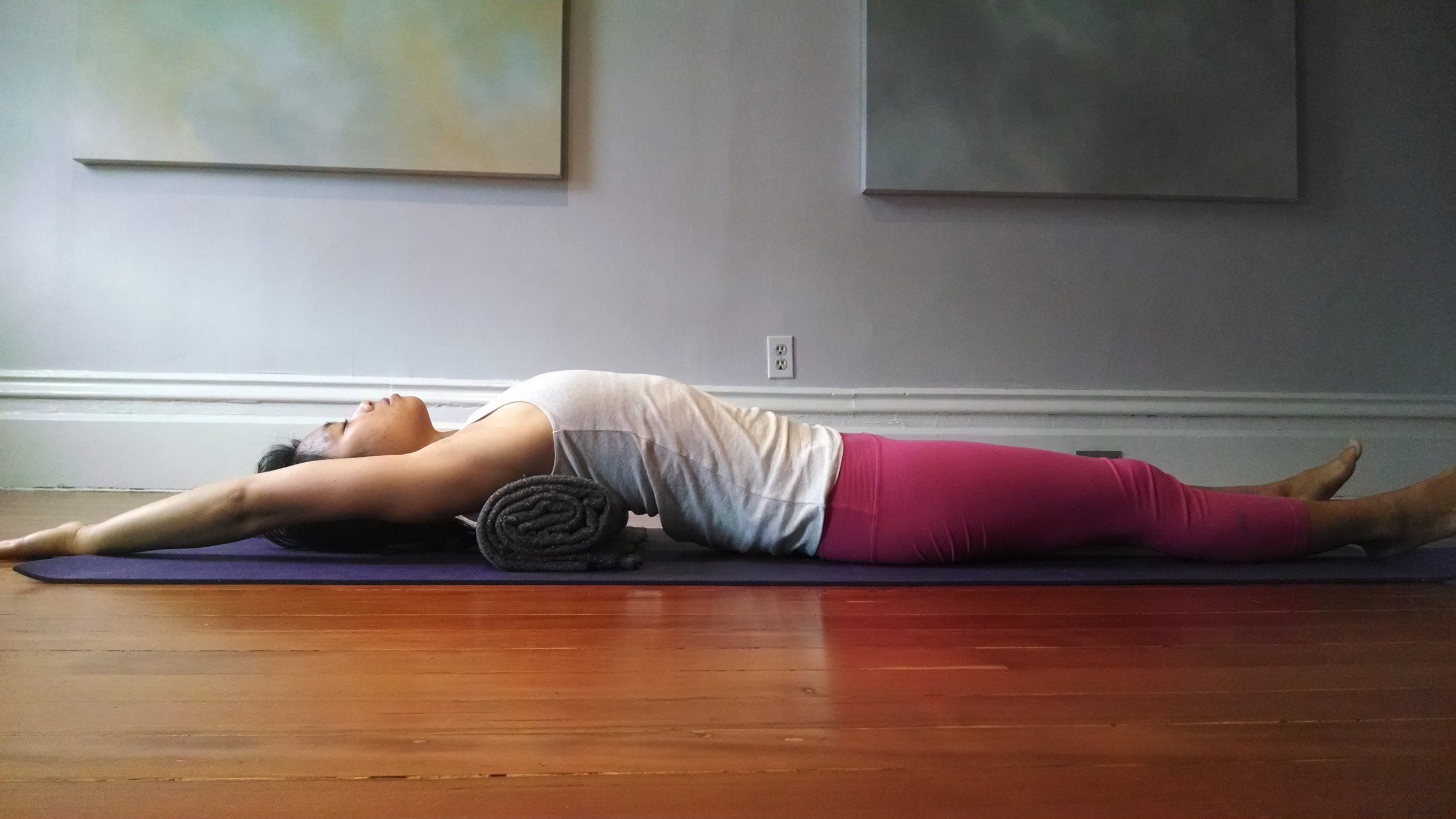 Upper back and chest opener. Feel free to bend the knees and place both feet on the floor if you have lower back tension. You can also place the arms down by your side.