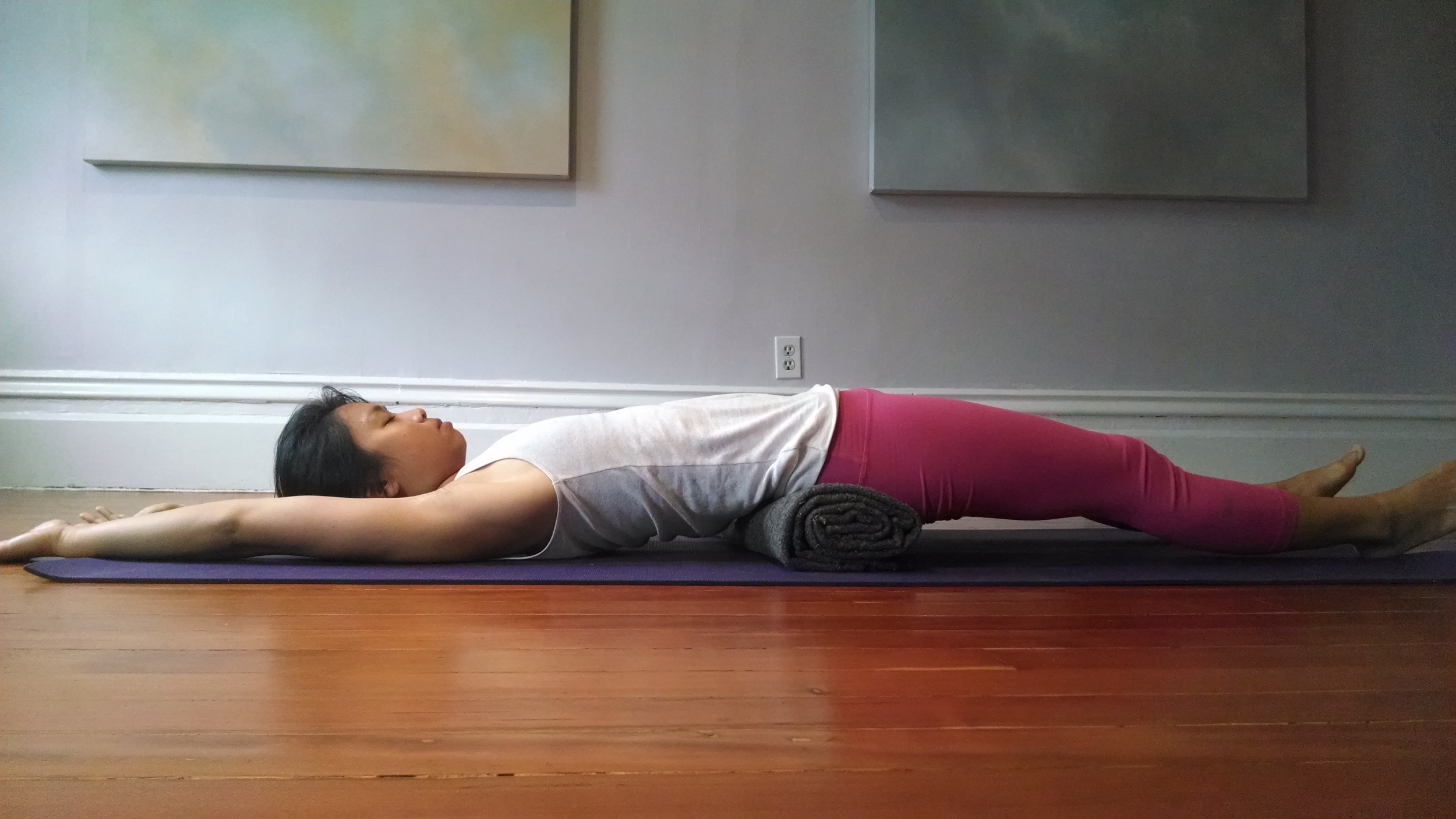 Lower back opener. Feel free to bend the knees and place both feet on the floor if you have lower back tension. You can also place the arms down by your side.