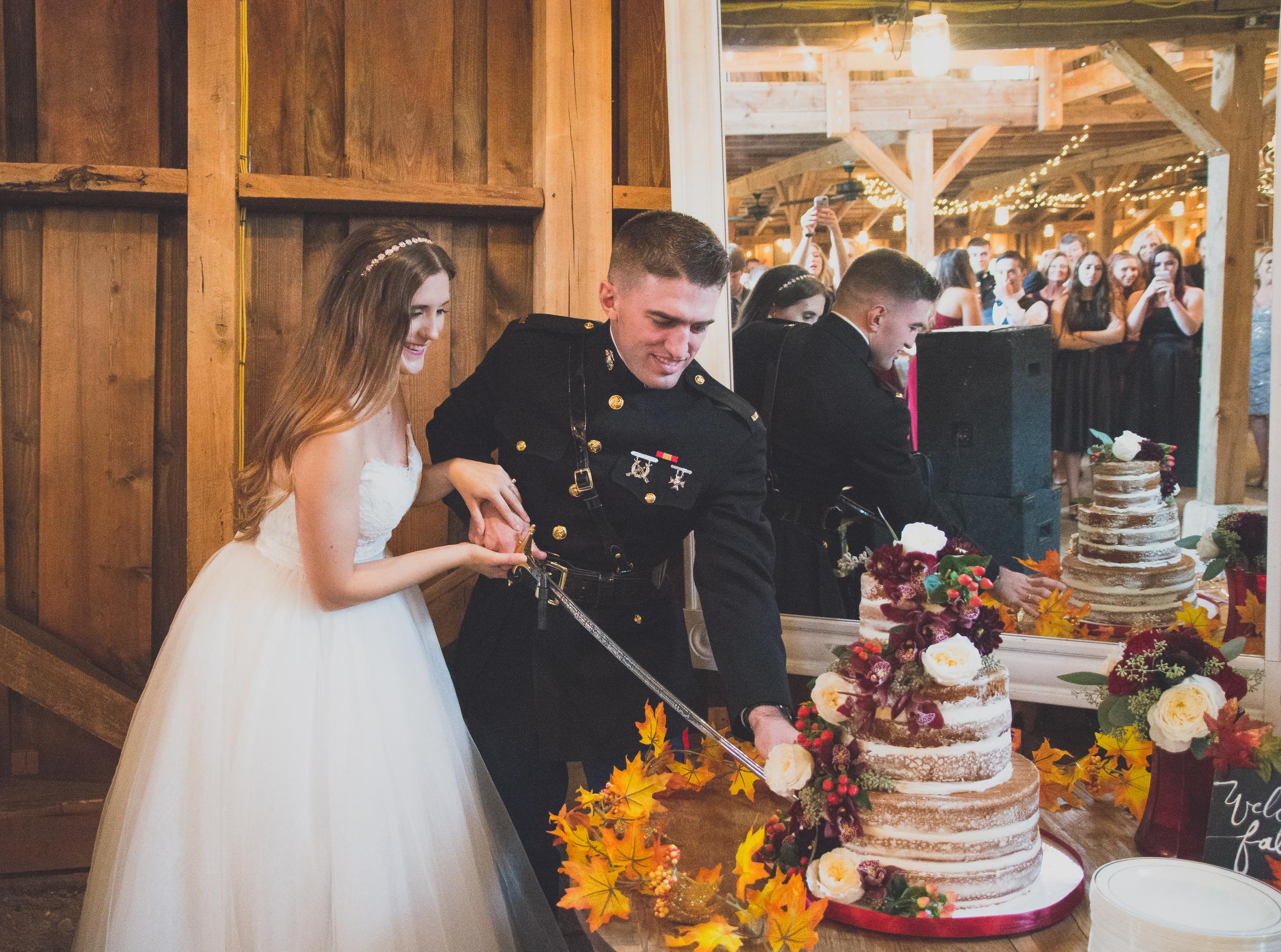 The Glasgow Farm Wedding bride and groom cutting cake Photo