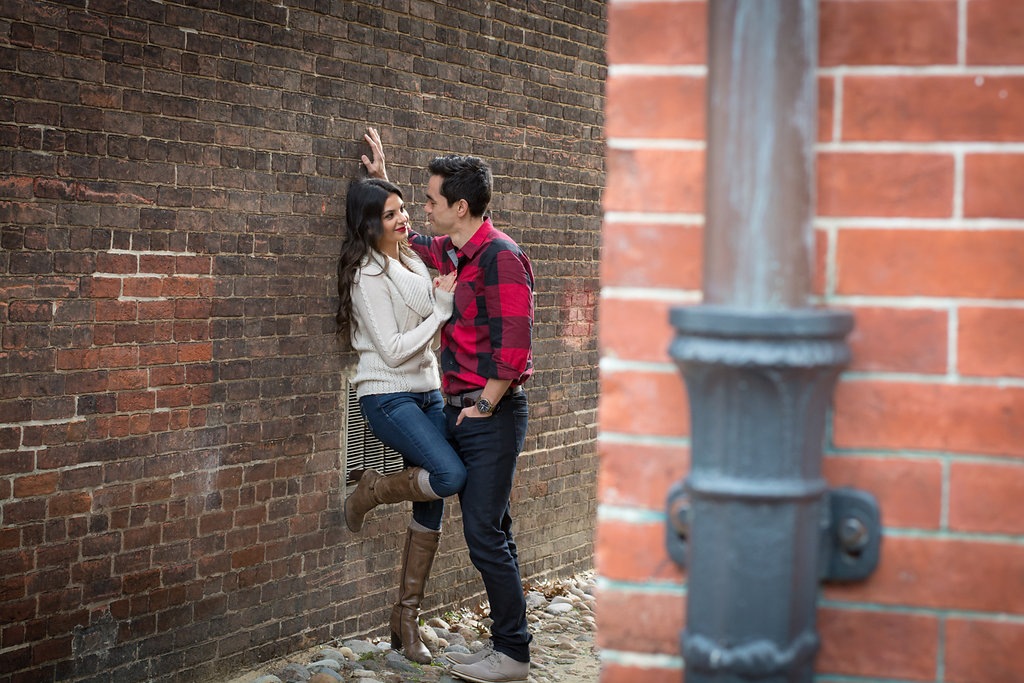 Old Town Alexandria Engagement couple leaning on brick wall Photo