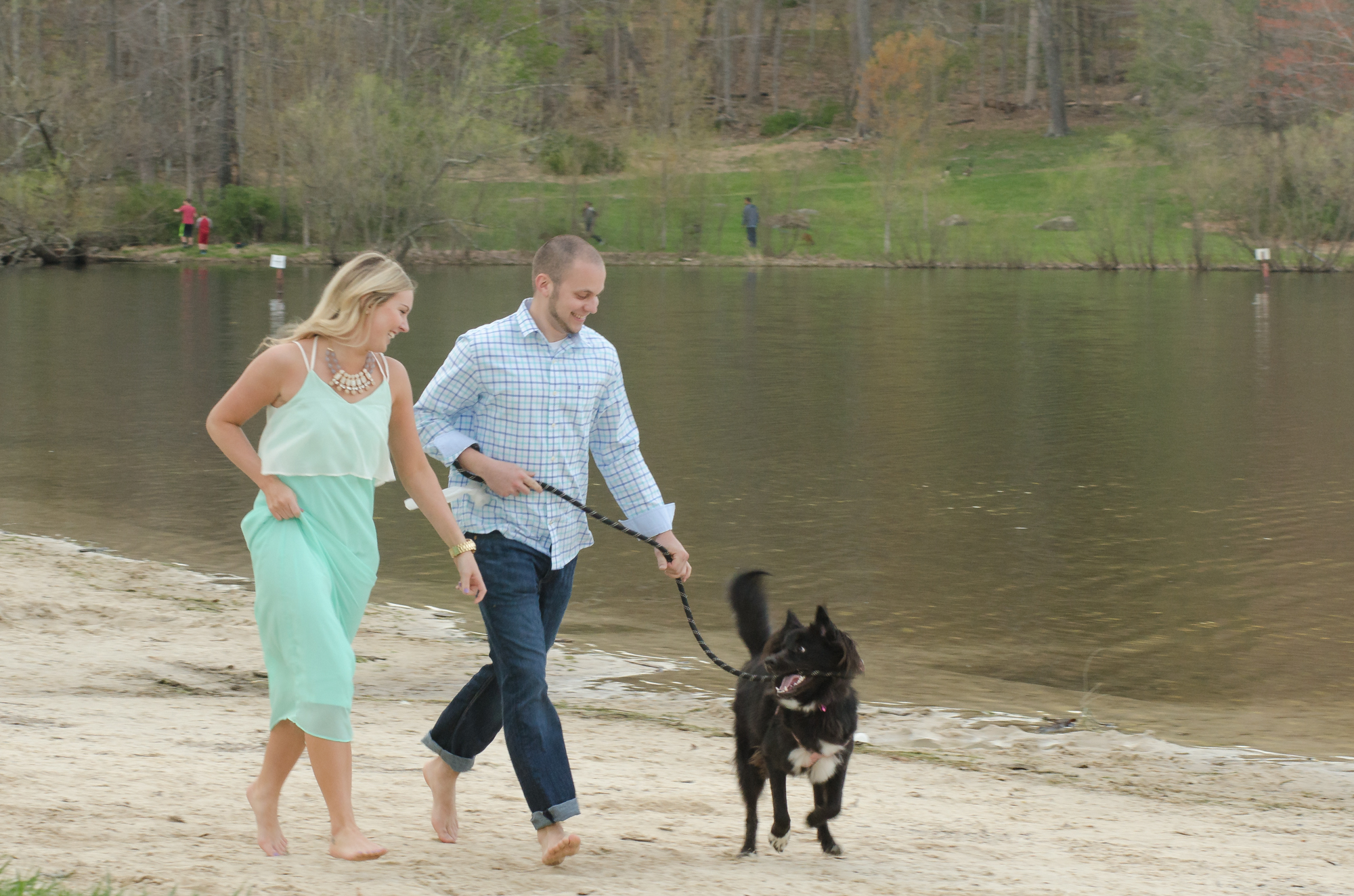 cunningham falls engagement session photo couple running with dog on beach