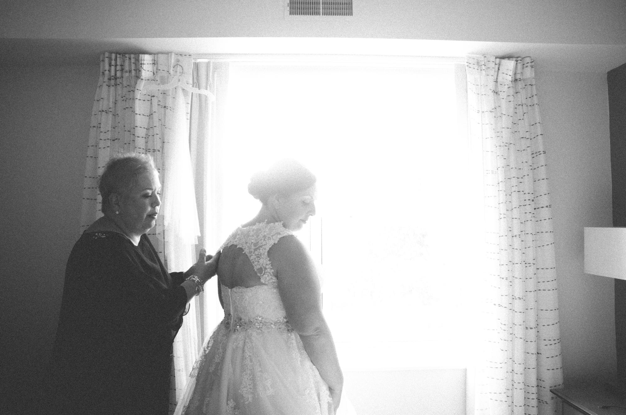 bride and mom getting ready wedding