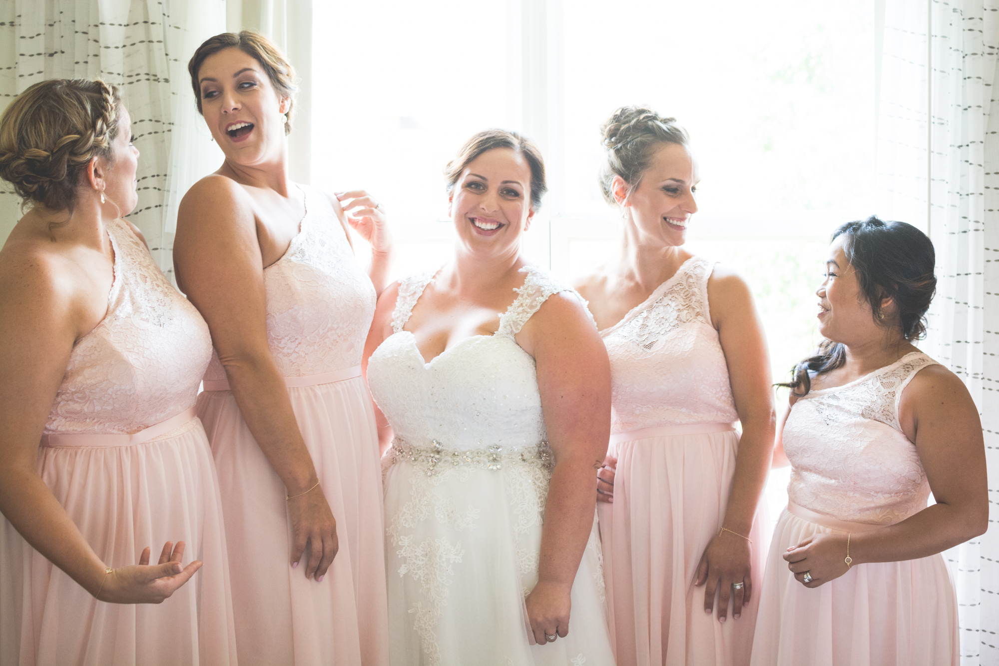 bridesmaids getting ready with bride