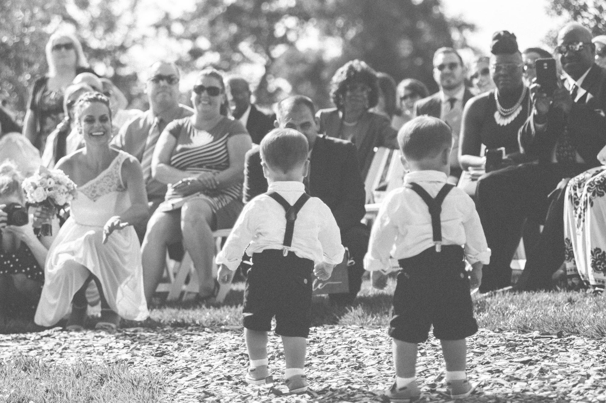 ring bearers walking down isle glen ellen farm