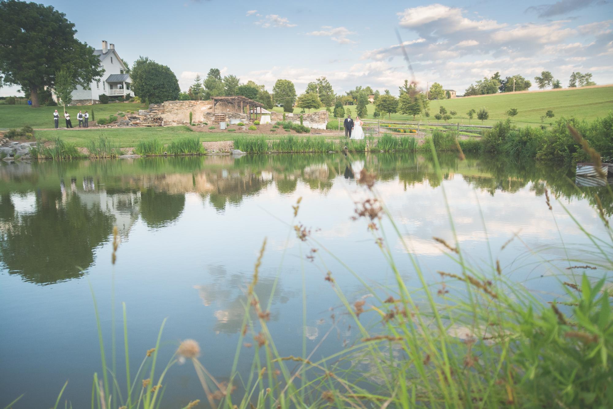 bride and groom on lake at glen ellen farm