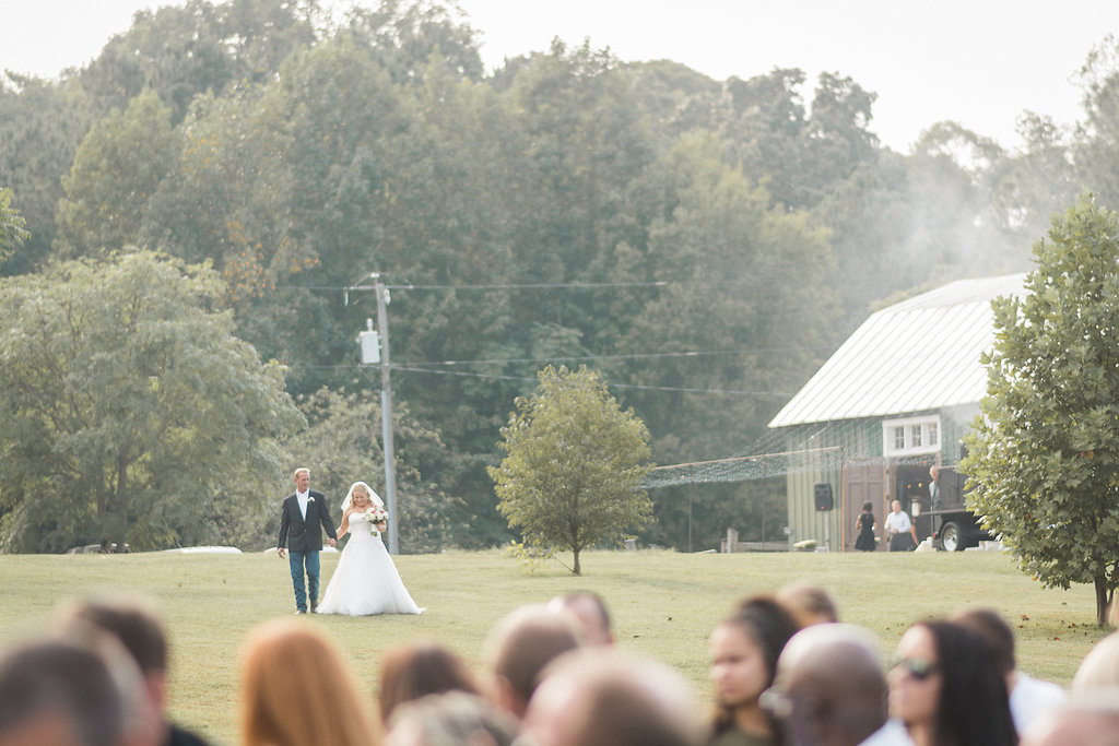 bride walking with father to ceremony photo