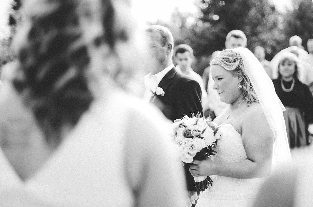 bride walking down wedding aisle photo