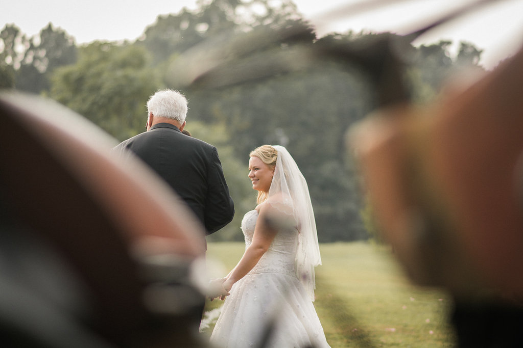 country bride and tractor at wedding ceremony photo