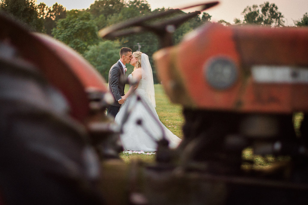 country bride and groom with tractor photo
