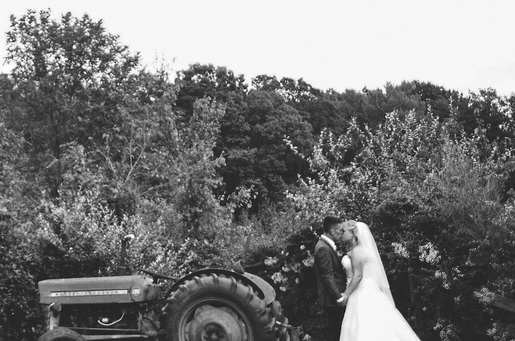 country bride and groom tractor photo