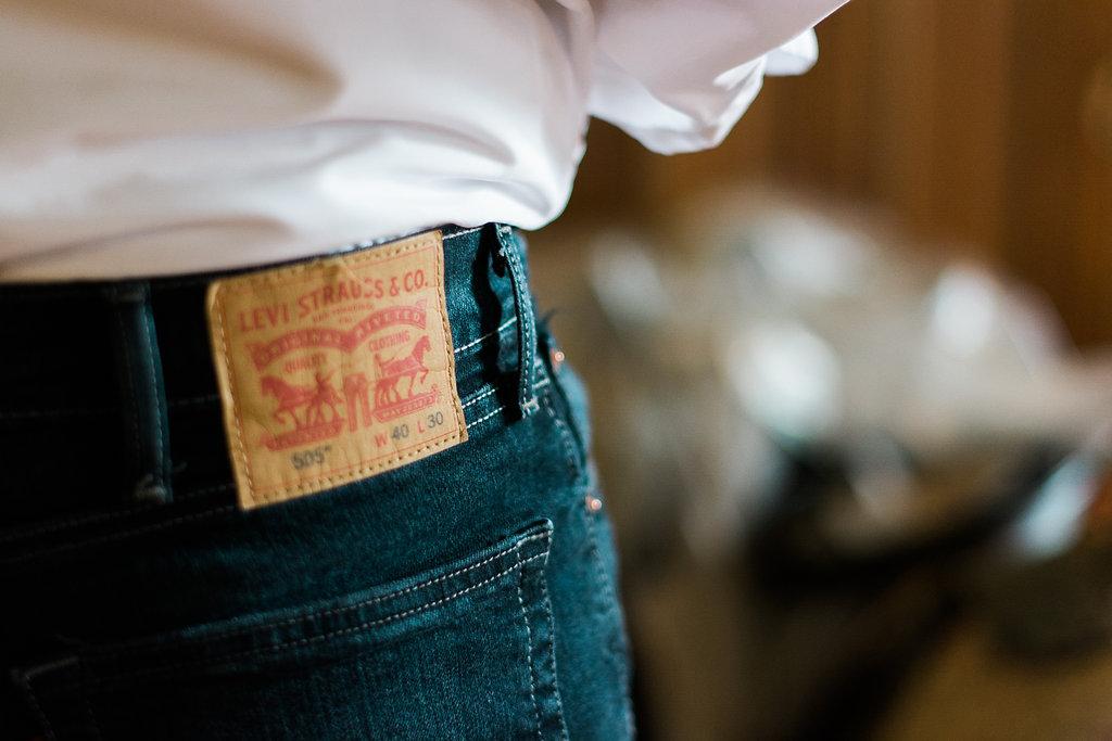 groom levis jeans wedding photo