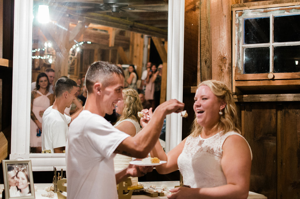 bride and groom cutting cake photo
