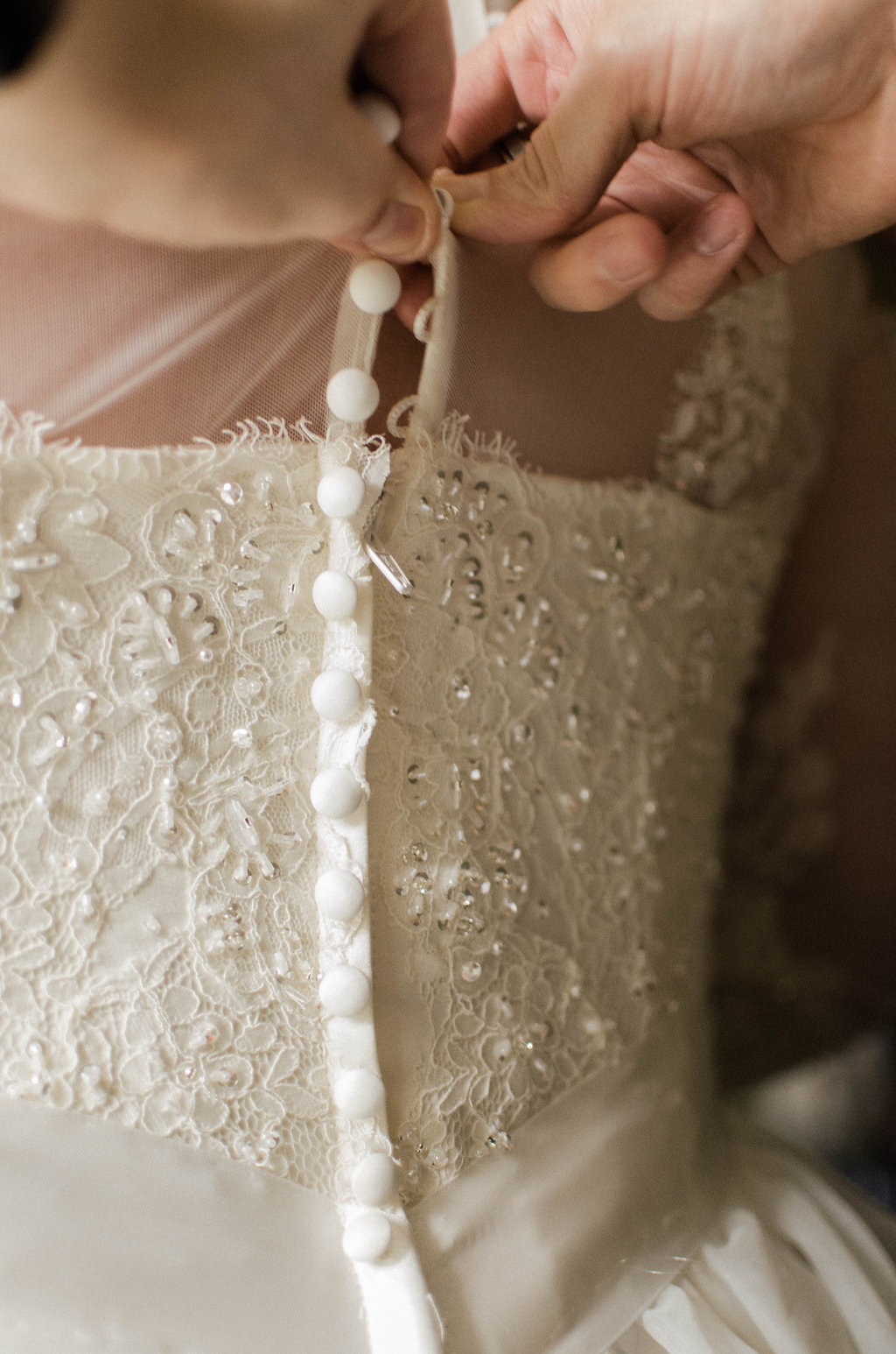 bride and mother wedding dress getting ready photo