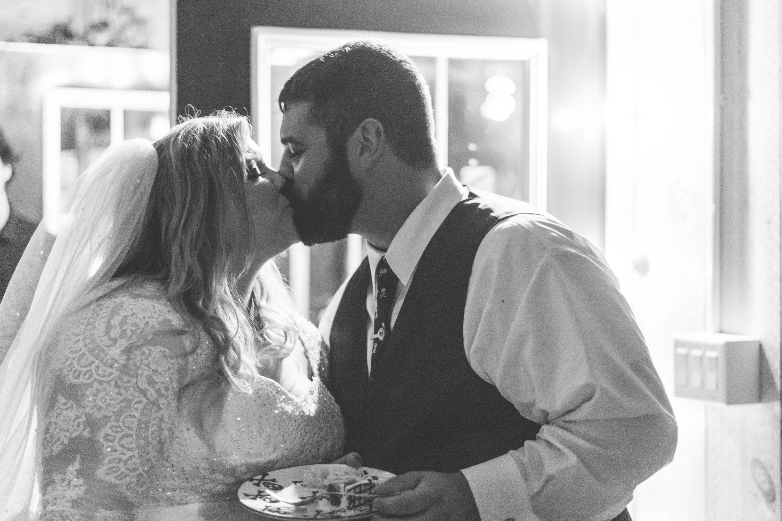 bride and groom cut cake photo