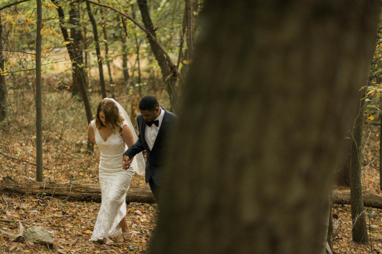 bride and groom walking in woods styled shoot photo