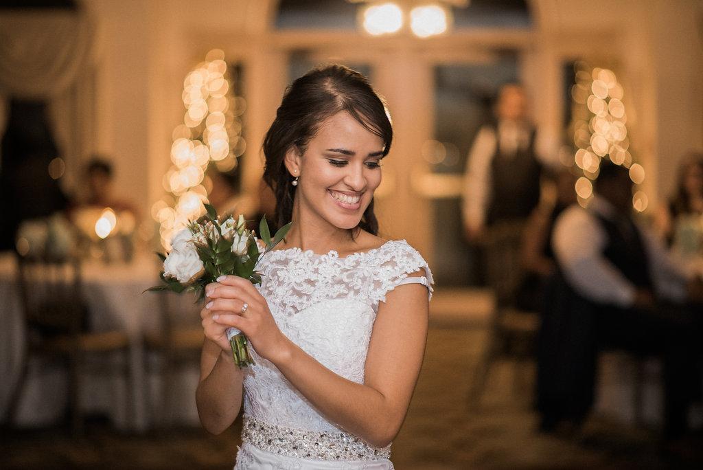 bride throwing bouquet ceresville mansion photo