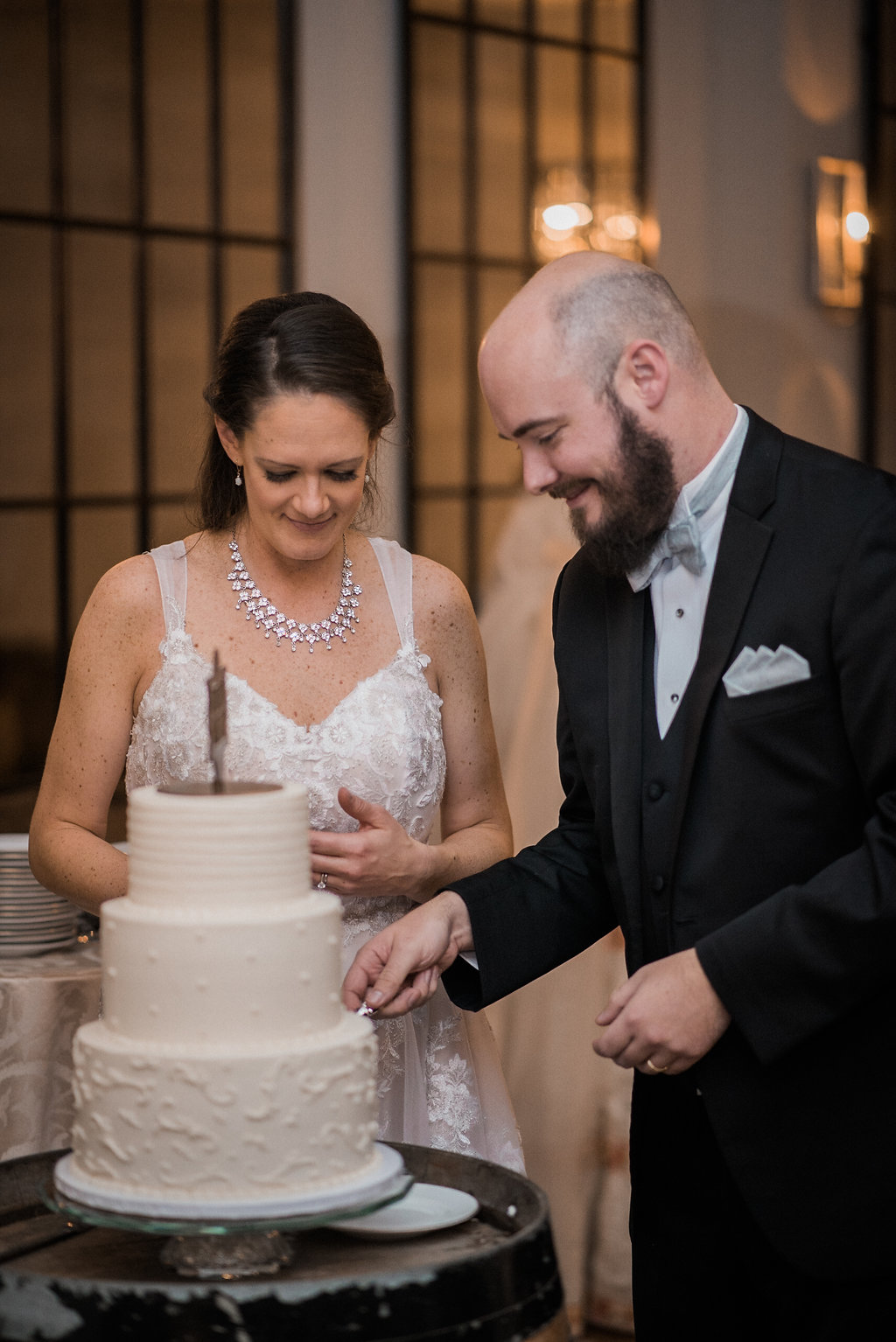 brid and groom cutting cake at stone tower winery photo