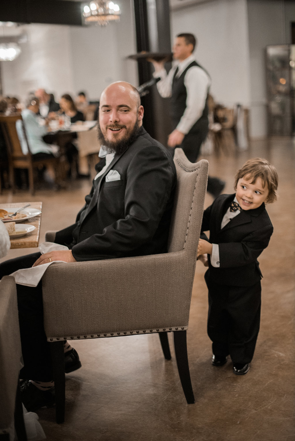 groom and ring bearer at stone tower wedding photo