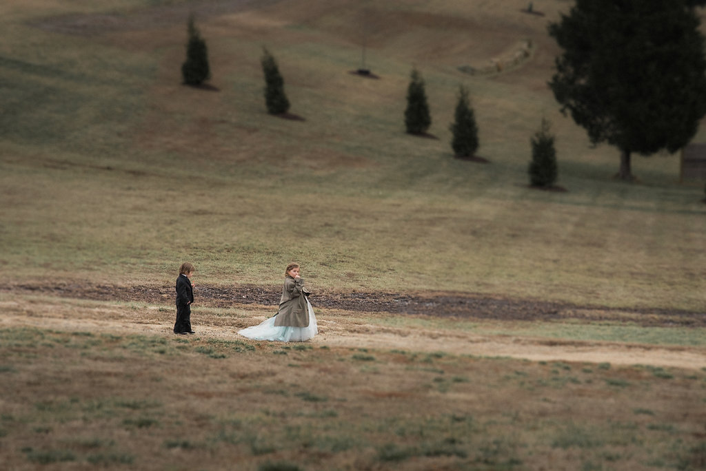ring bearer and flower girl at stone tower winery wedding photo