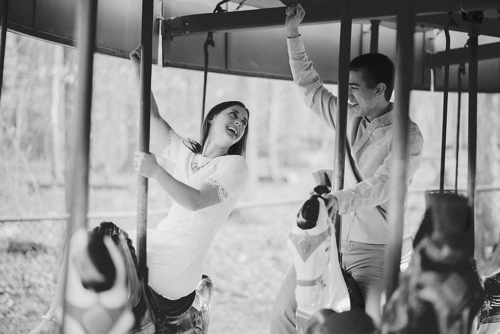 Couple on carousel in black and white