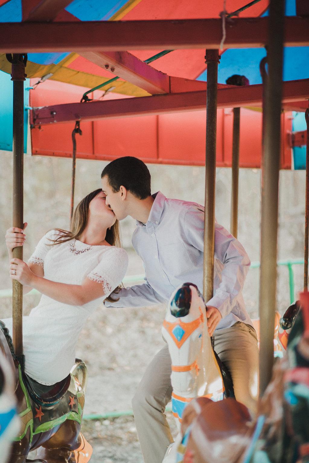 Couple kissing on carousel
