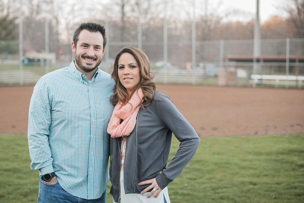 Couple on baseball field