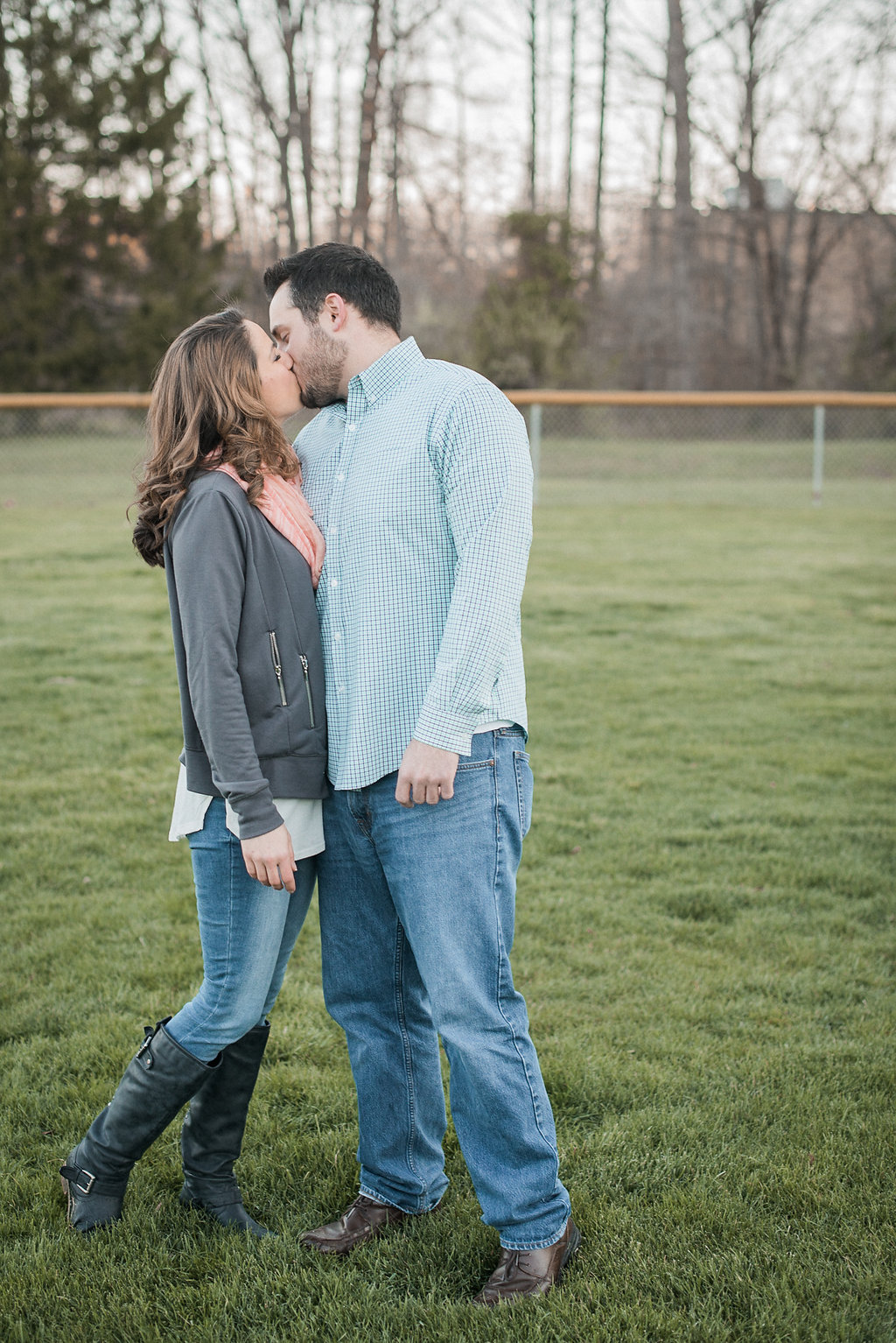 Couple kissing on baseball field