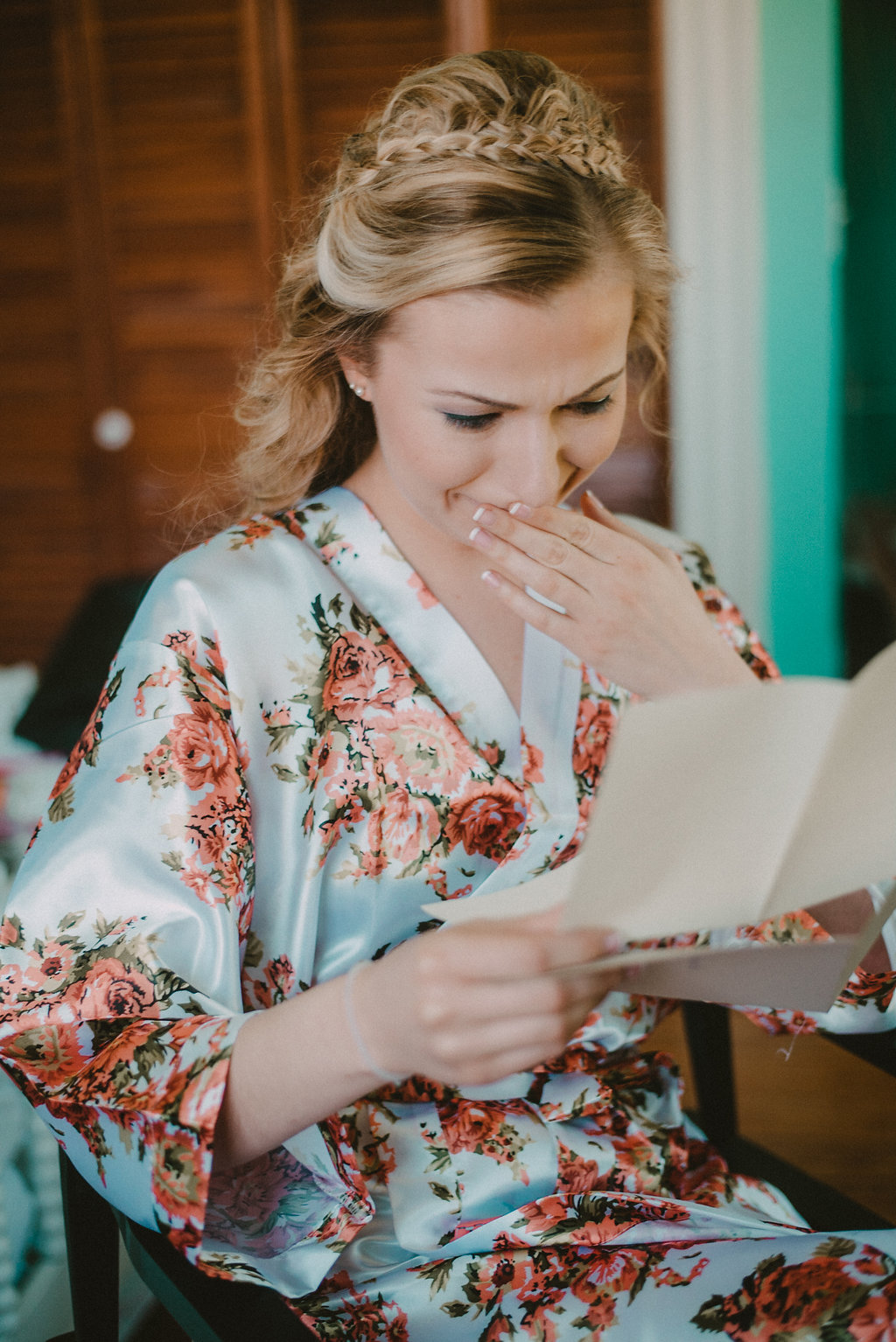 Bride reading letter and crying