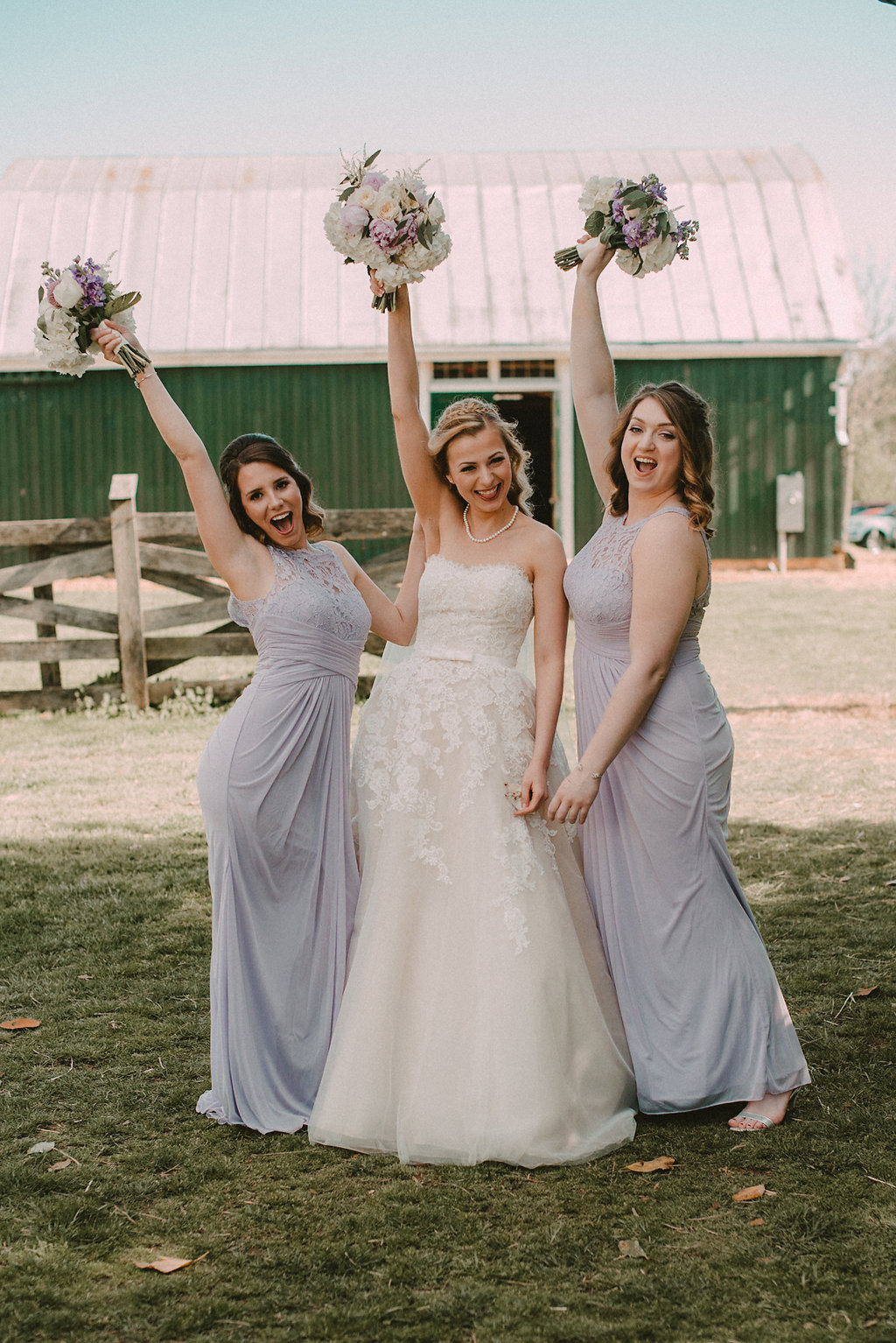 Bride and bridesmaids posing with bouquets