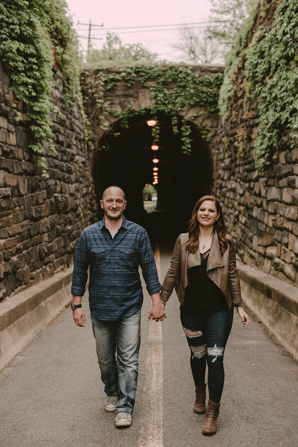 Man and woman walking through tunnel
