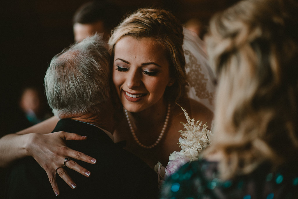 grandfather giving granddaughter away at wedding