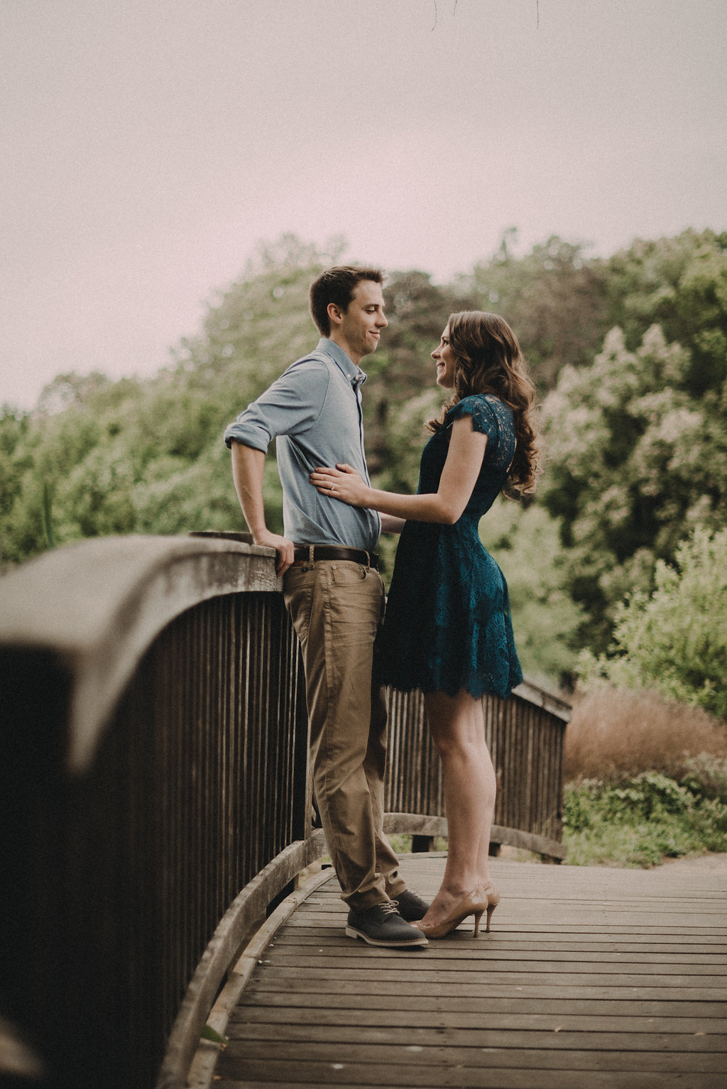 Couple standing on bridge