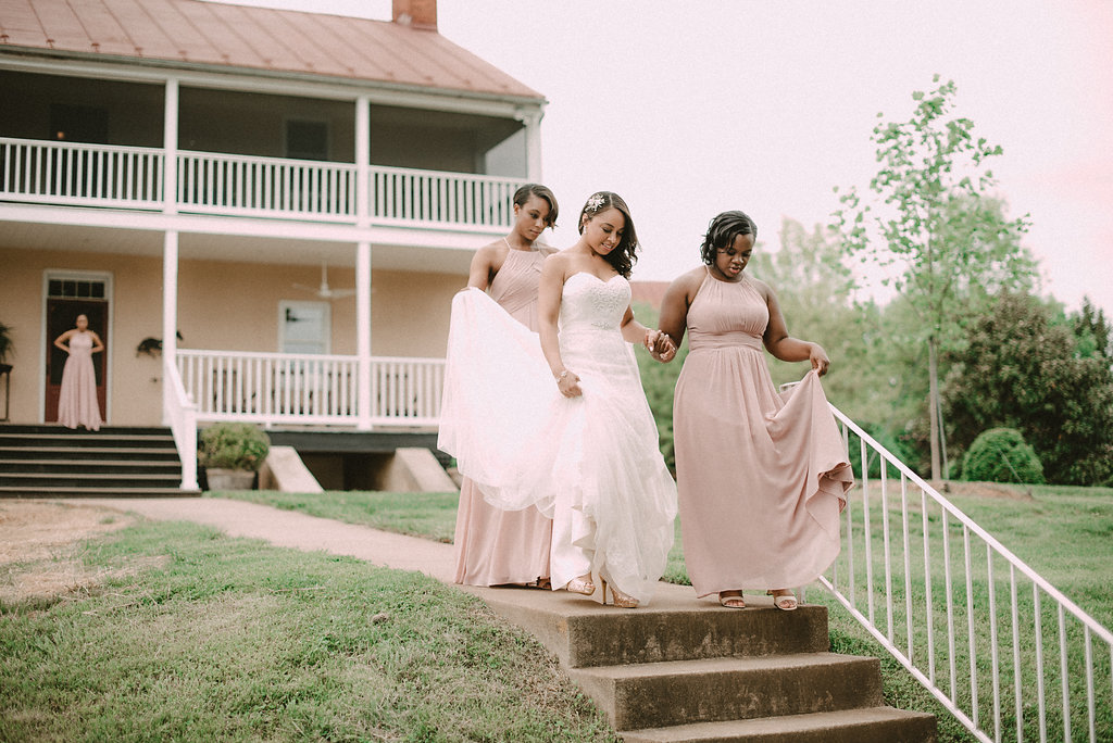 Bride leaving house with bridesmaids