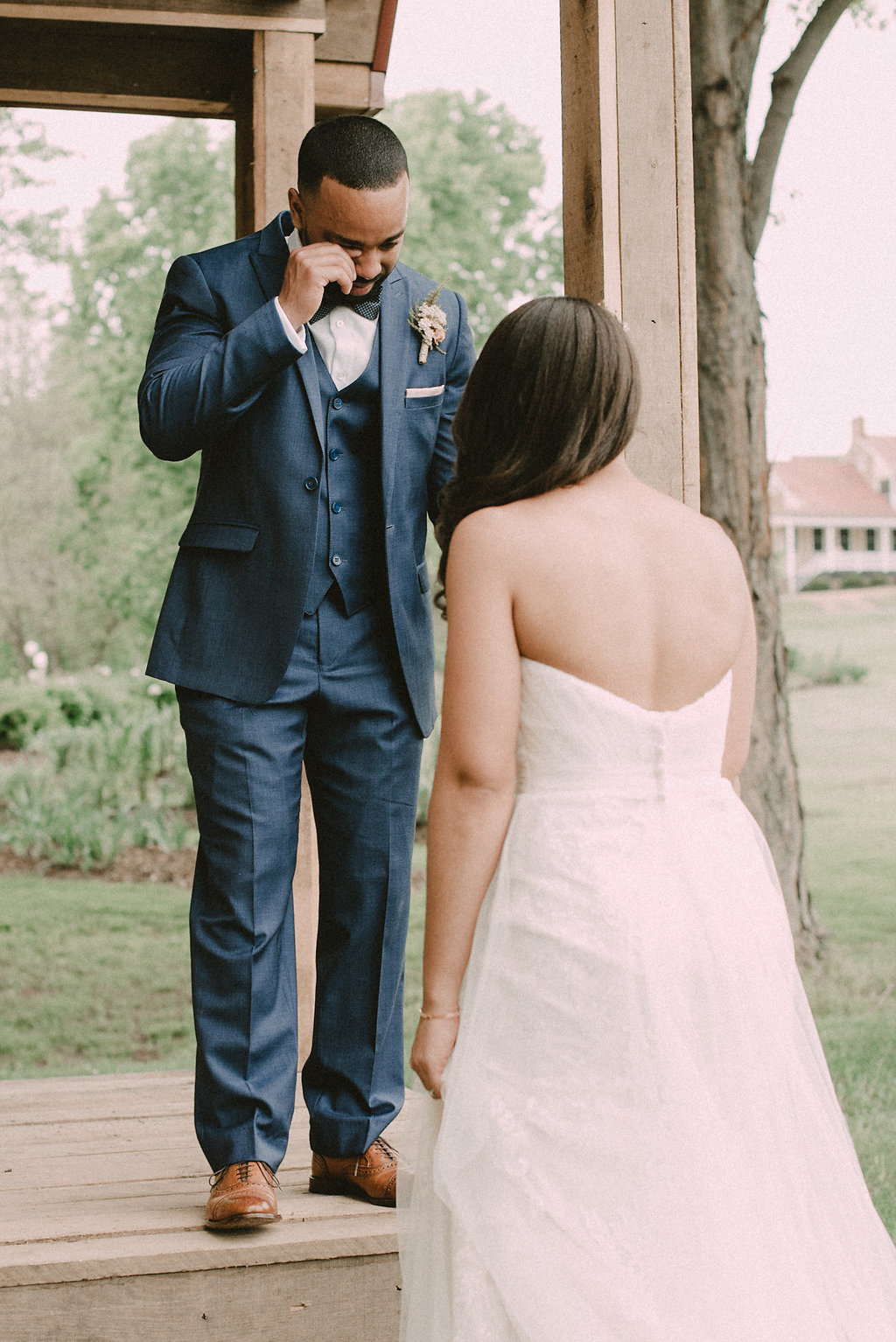 Groom crying when seeing bride