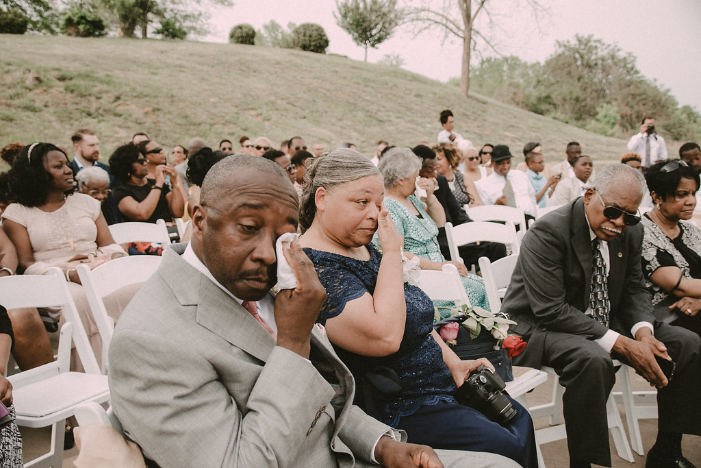 Parents crying at wedding ceremony