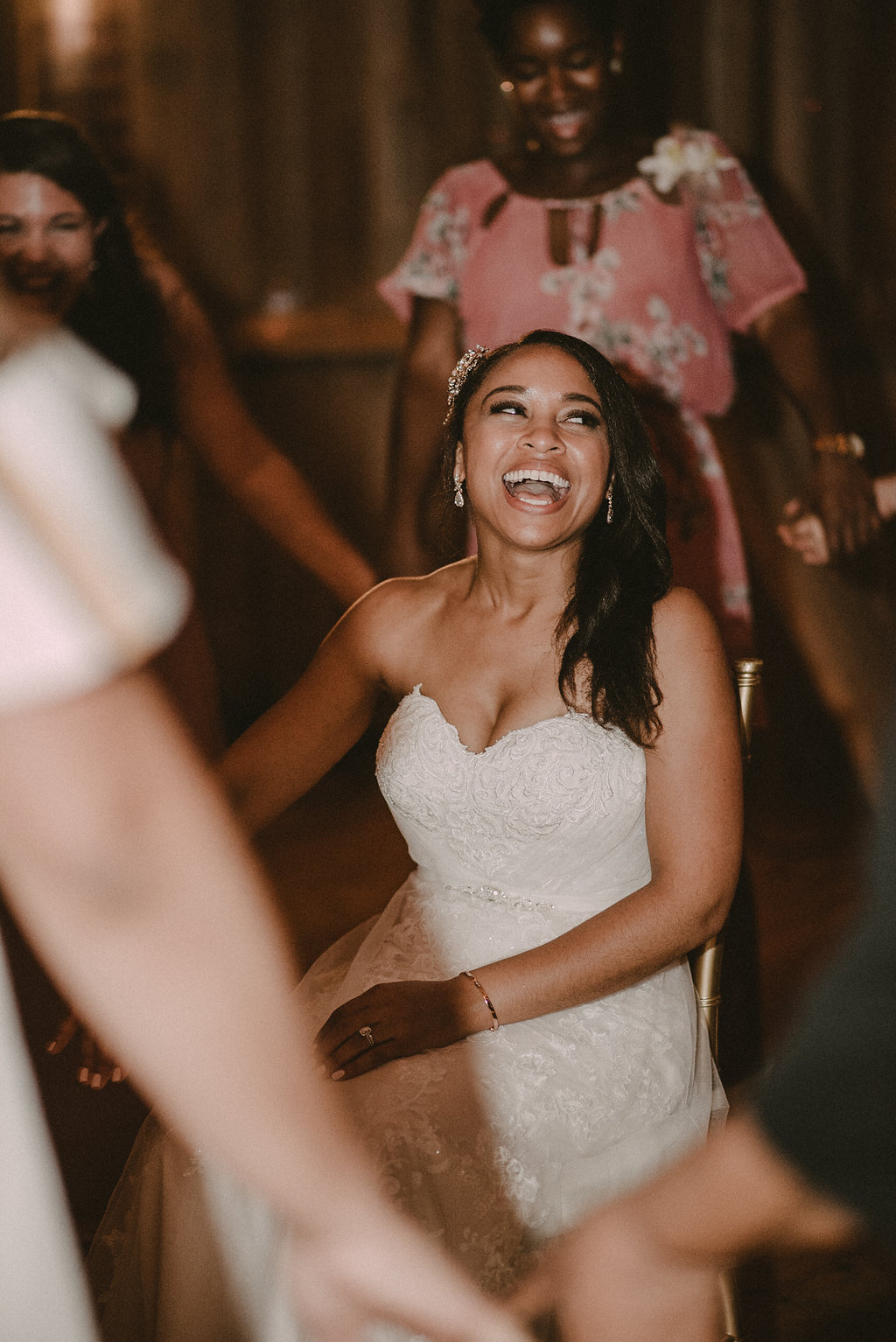 Bride laughing at wedding reception