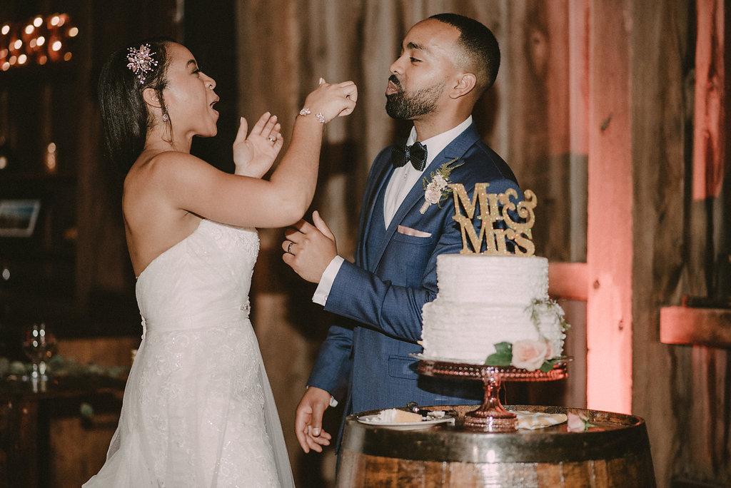 Bride feeding groom cake