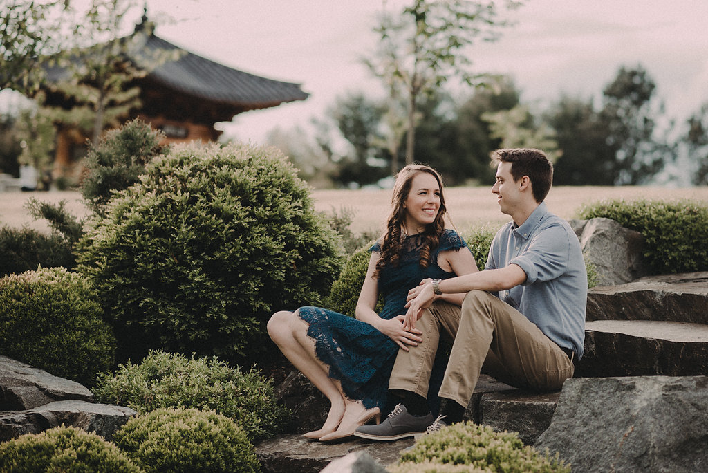 couple sitting in front of japanese architecture