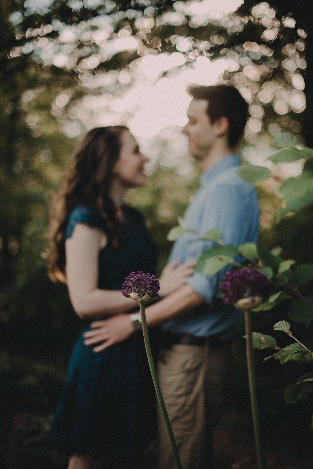 engaged couple in embracing one another at meadowlark gardens