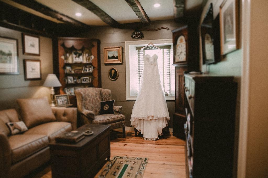 bride dress in rustic cabin room photo