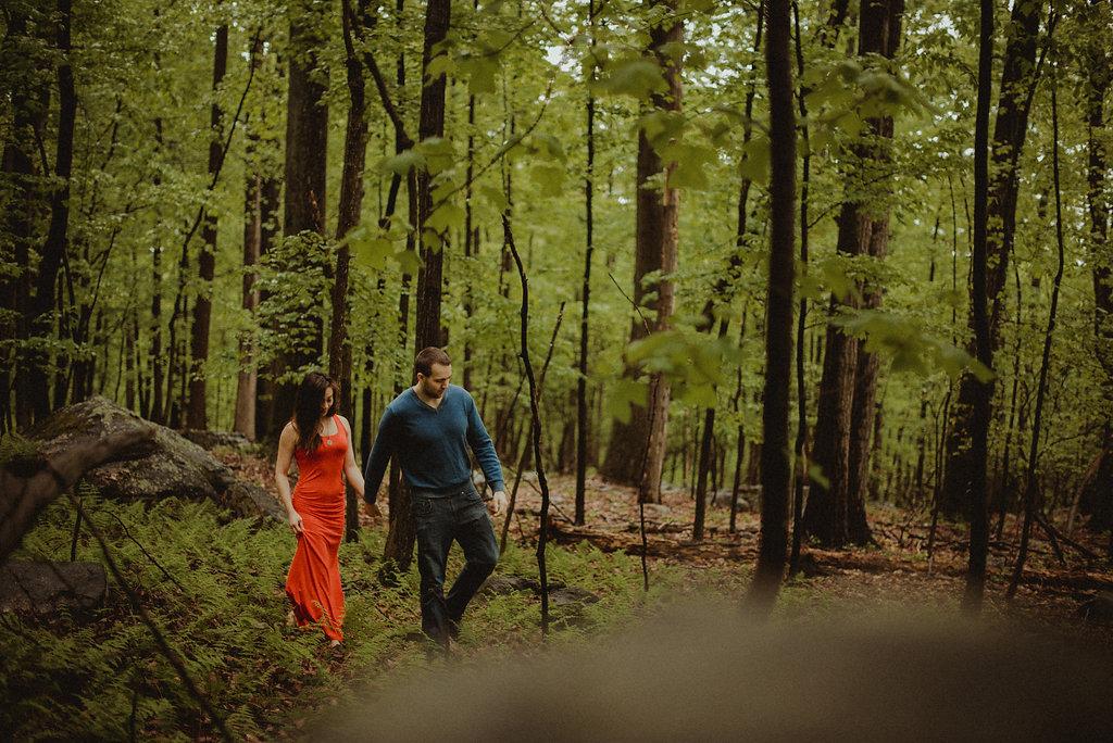 Woman and man walking through woods