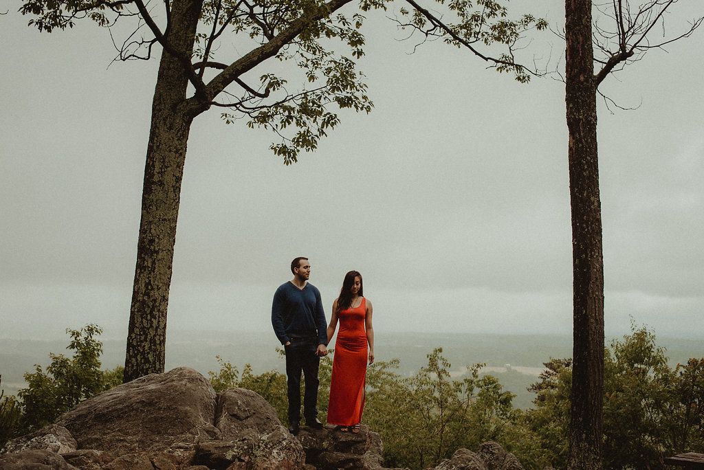 Man and woman standing on mountain