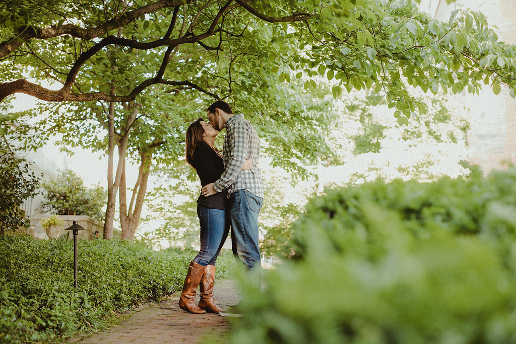 Man and woman kissing in garden