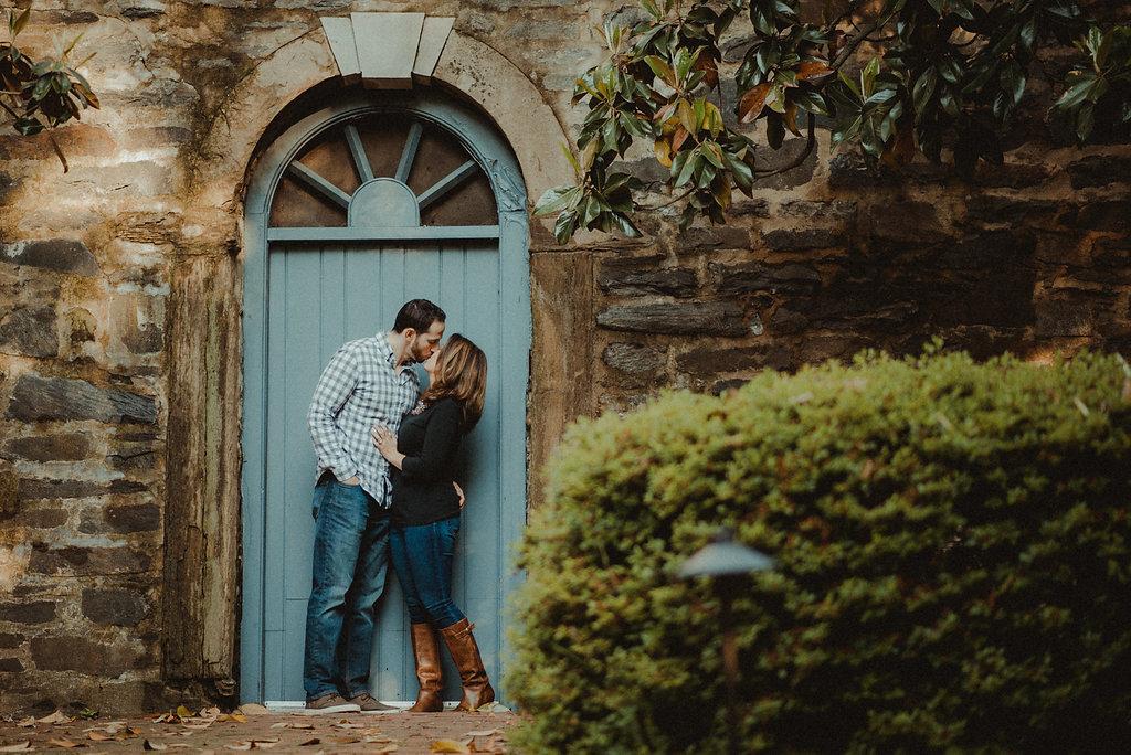 Couple standing at blue door