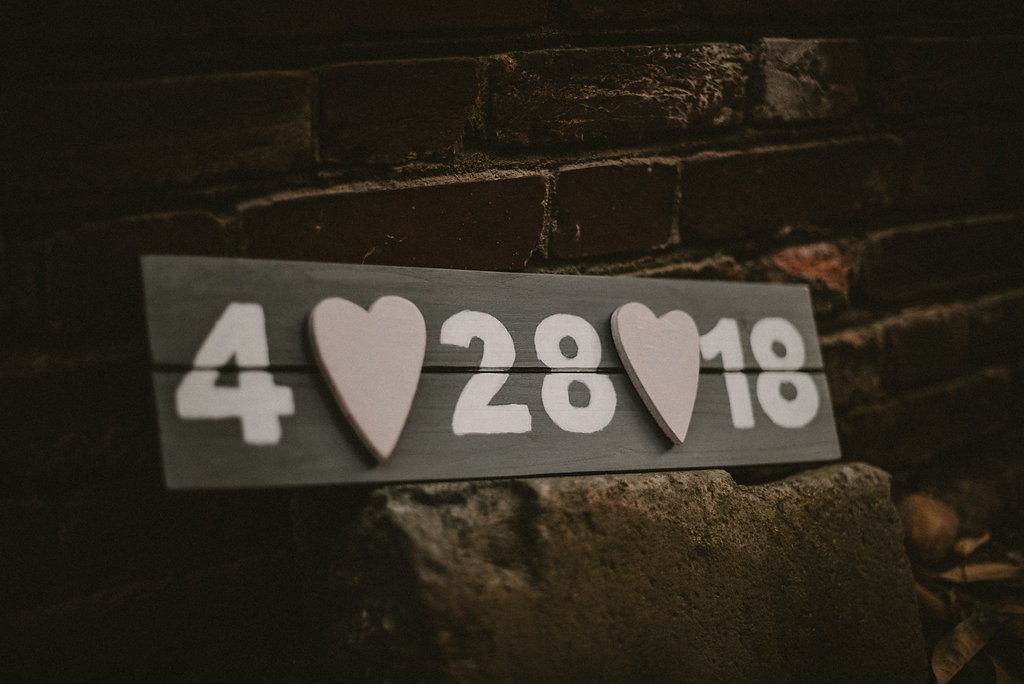 Wedding date sign by brick wall