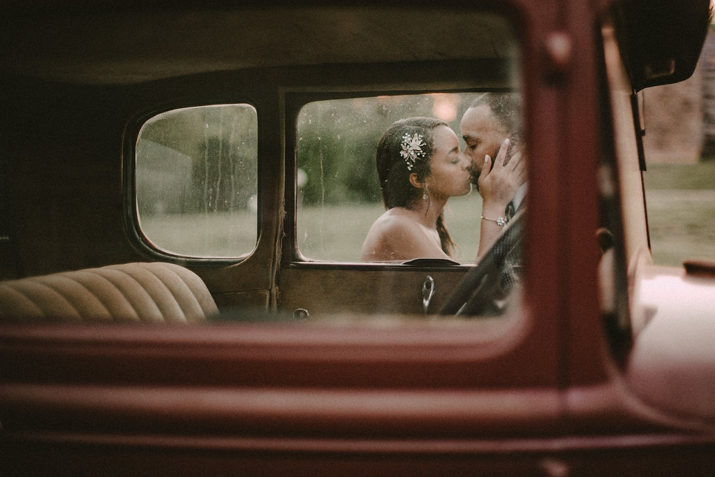 bride and groom posing by vintage truck photo