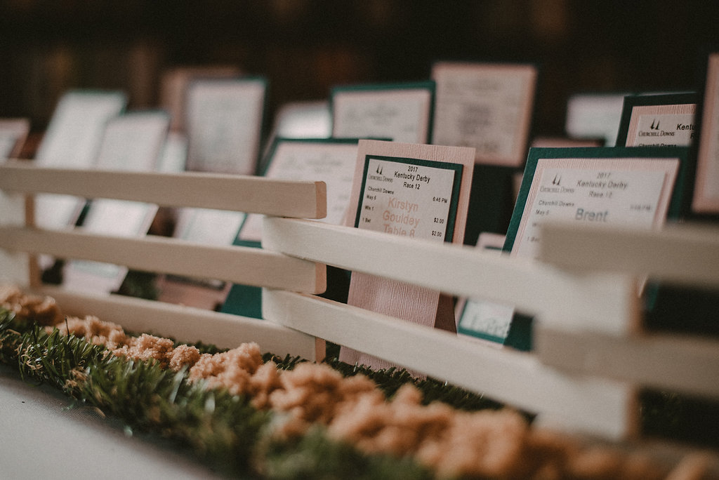 Derby themed place cards at wedding